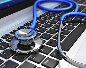 stetoscopio su tastiera computer