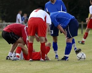giocatore di calcio infortunato